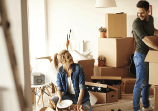 Couple moving in and unpacking boxes